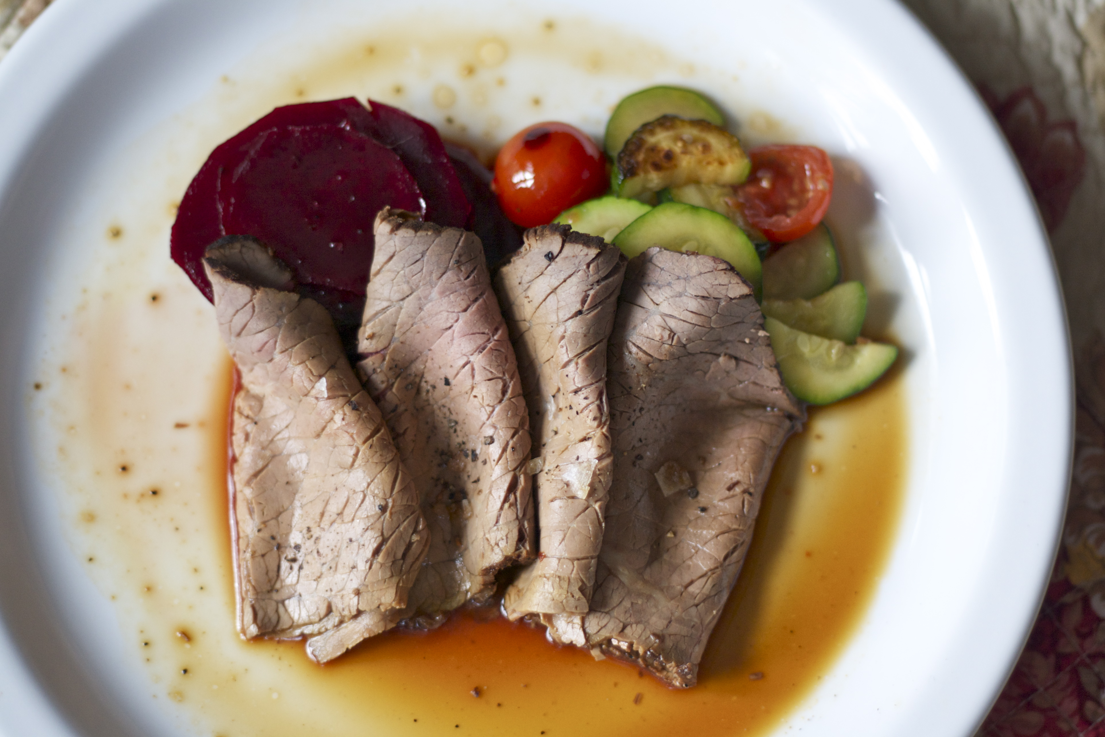 GAPS diet legal roast beef recipe on plate with vegetables, from Christina at Edible Times.